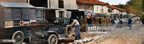 The US Post Office and ambulance trucks with the Red Cross in DieuesurMeuse north of Verdun September 1916 Battle of Verdun Western Front World War I...