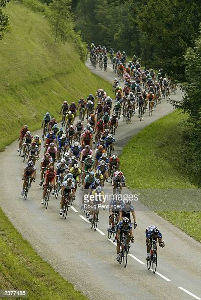 The US Postal Berry Floor team leads the descent of the Col de Latrape as they defended Lance Armstrong's yellow jersey during stage 14 of the Tour...