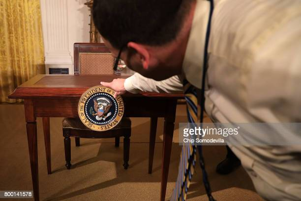 The US presidential seal is affixed to a table where President Donald Trump will sign the Department of Veterans Affairs Accountability and...