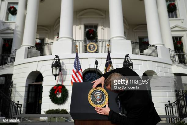 The US presidential seal is placed on the lecturn ahead of an event to celebrate Congress passing the Tax Cuts and Jobs Act on the South Lawn of the...