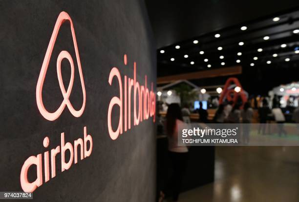 The US rental site Airbnb logo is displayed during the company's press conference in Tokyo on June 14 2018 / The erroneous mention[s] appearing in...