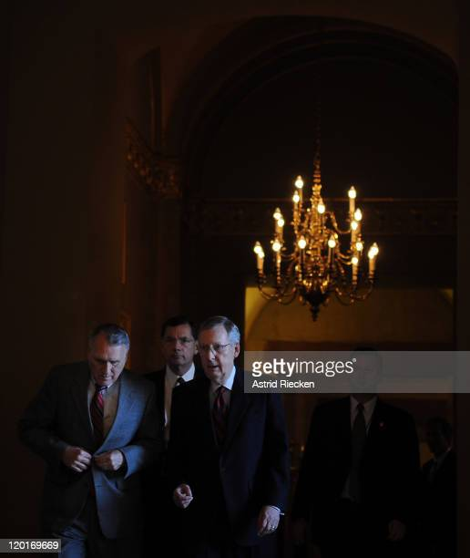 The US Senate Minority Leader Mitch McConnell and Minority Whip Jon Kyl walk to the Senate chamber for a vote at the Capitol on July 31 2011 in...