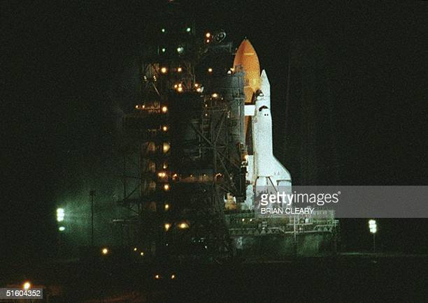 The US space shuttle Columbia sits on launch pad 39B at the Kennedy Space Center in FL early 20 July 1999 after the launch was aborted only six...