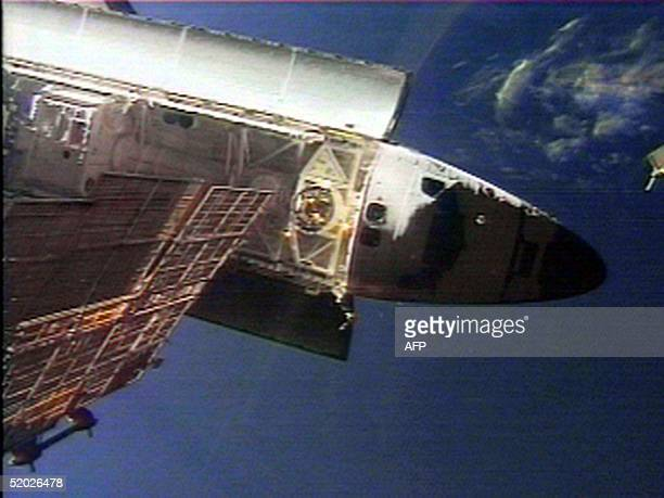 The US space shuttle Discovery is seen from the Russian space station Mir 08 June to do a flyaround of the station and then prepare for the trip back...