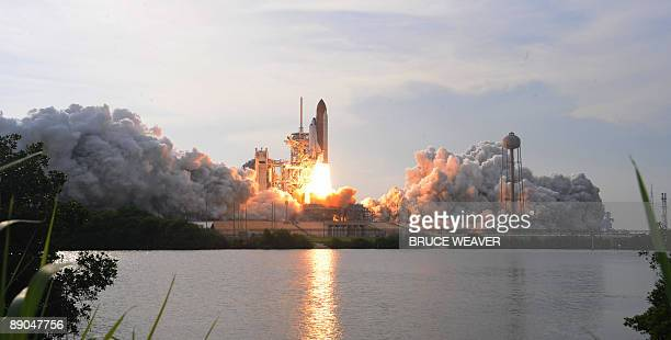 The US space shuttle Endeavour lifts off July 15, 2009 from Kennedy Space Center in Florida, its sixth bid in recent weeks to launch toward the...