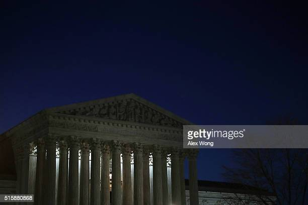 The US Supreme Court building is seen at dawn on March 16 2016 in Washington DC President Barack Obama will announce his nominee to succeed the late...