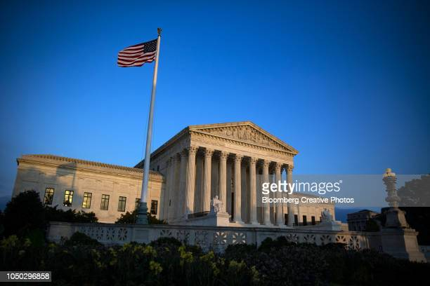 the u.s. supreme court building stands in washington - supreme court stock pictures, royalty-free photos & images