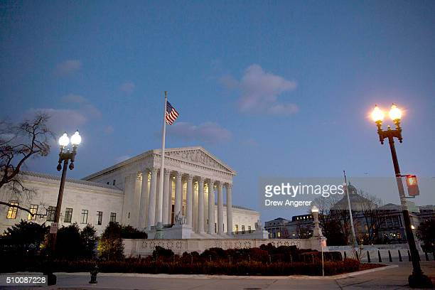 The US Supreme Court is seen at dusk February 13 2016 in Washington DC Supreme Court Justice Antonin Scalia was at a Texas Ranch Saturday morning...