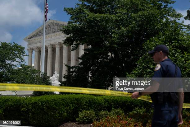 The US Supreme Court is seen behind trees after it ruled that states may collect sales tax from retailers that do not have a physical presence on...