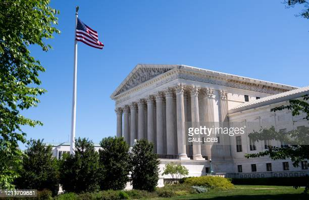 The US Supreme Court is seen in Washington, DC, on May 4 during the first day of oral arguments held by telephone, a first in the Court's history, as...