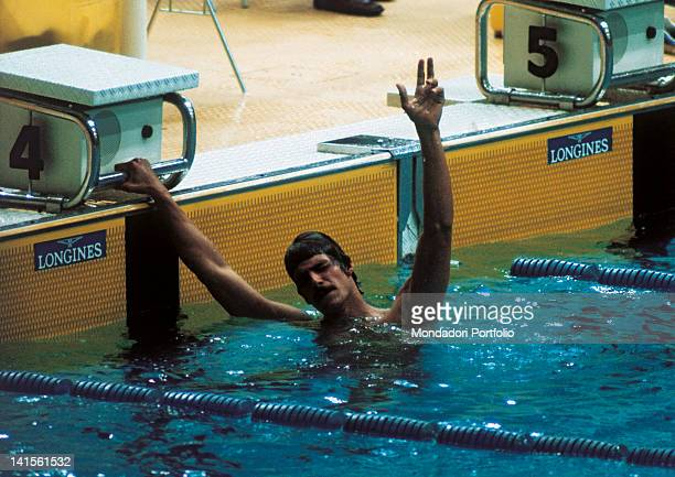 The US swimmer Mark Spitz greets the public making 'three' with his fingers after having won the 200 metres freestyle final and the third of his...