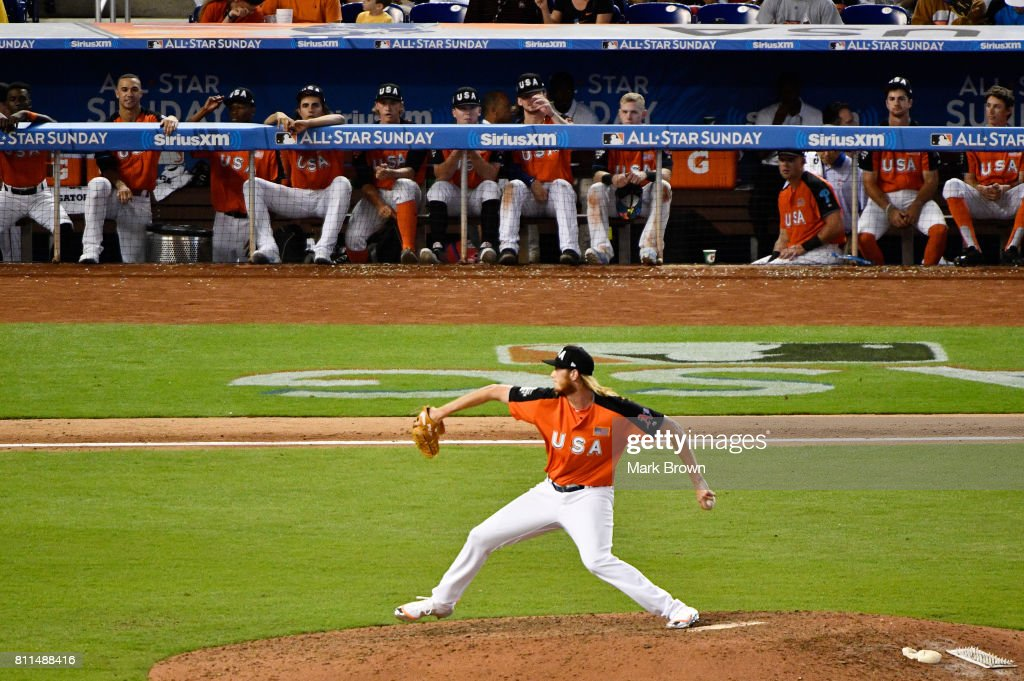 The U.S. Team bench looks on as A.J. Puk #44 of the Oakland Athletics and the U.S. Team pitches against the World Team during the SiriusXM All-Star Futures Game at Marlins Park on July 9, 2017 in Miami, Florida.