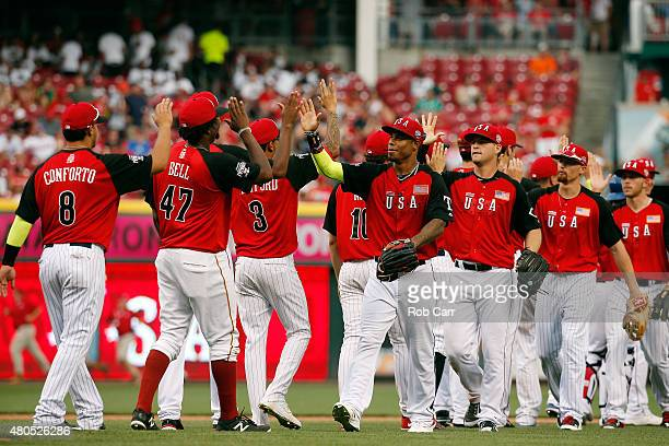 The U.S. Team celebrates after defeating the World Team 10-1 in the SiriusXM All-Star Futures Game at the Great American Ball Park on July 12, 2015...