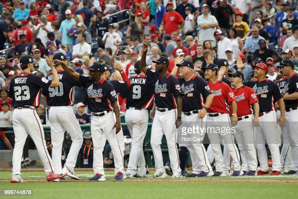 The U.S. Team celebrates after defeating the World Team in the SiriusXM All-Star Futures Game at Nationals Park on July 15, 2018 in Washington, DC.