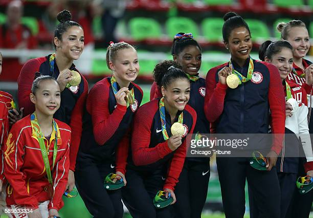 The US team celebrates their gold medal in the women's gymnastics team final on Aug 9 2016