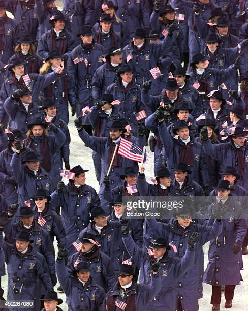The US Team enters Olympic Stadium with Eric Flaim carrying flag