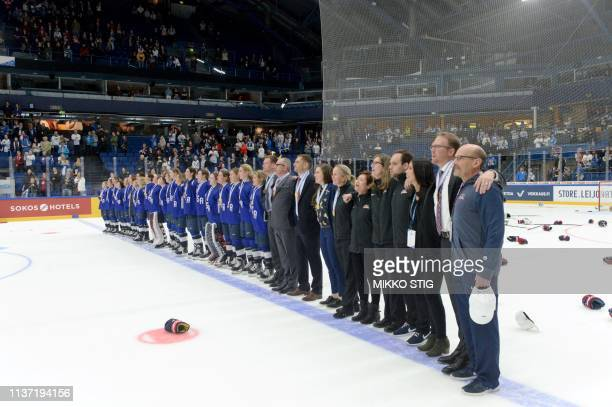The US team listen to their national anthem during the medal ceremony after their 21 shootout victory during the IIHF Women's Ice Hockey World...