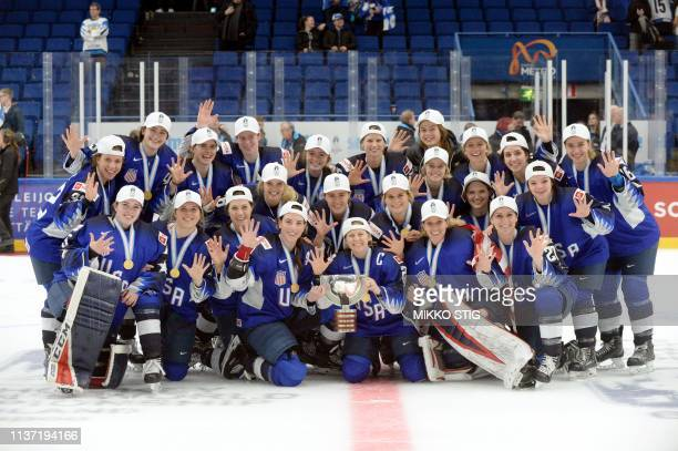 The US team pose with their gold medals during the medal ceremony after their 21 shootout victory during the IIHF Women's Ice Hockey World...