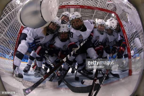 TOPSHOT The US team poses for a photo before the women's preliminary round ice hockey match between the US and Canada during the Pyeongchang 2018...