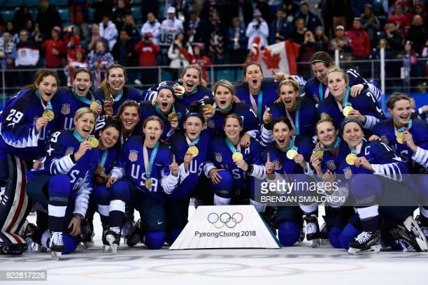 TOPSHOT The US team poses with their gold medals after the medal ceremony after the women's ice hockey event during the Pyeongchang 2018 Winter...