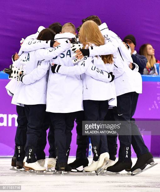 The US team react during the venue ceremony after winning bronze in the figure skating team event during the Pyeongchang 2018 Winter Olympic Games at...