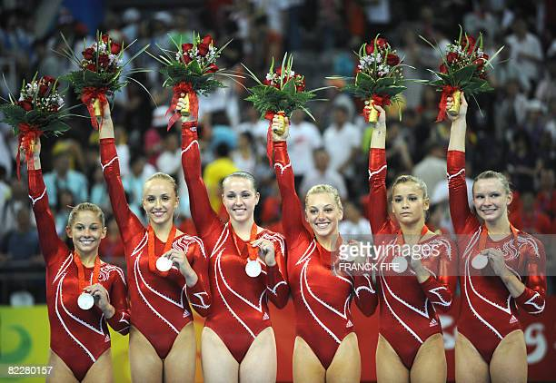 The US team stands on the podium after winning the silver in the women's team final of the artistic gymnastics event of the Beijing 2008 Olympic...