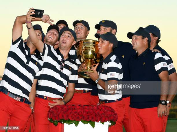 The US Team takes a selfie with the Presidents Cup trophy after clinching the win during the Sunday singles matches at the Presidents Cup at Liberty...