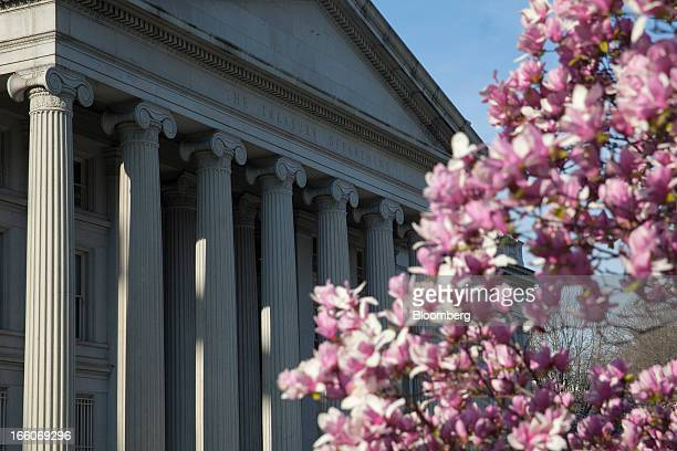 The US Treasury stands behind a flowering magnolia tree in Washington DC US on Monday April 8 2013 Michel Barnier the European Union financial...