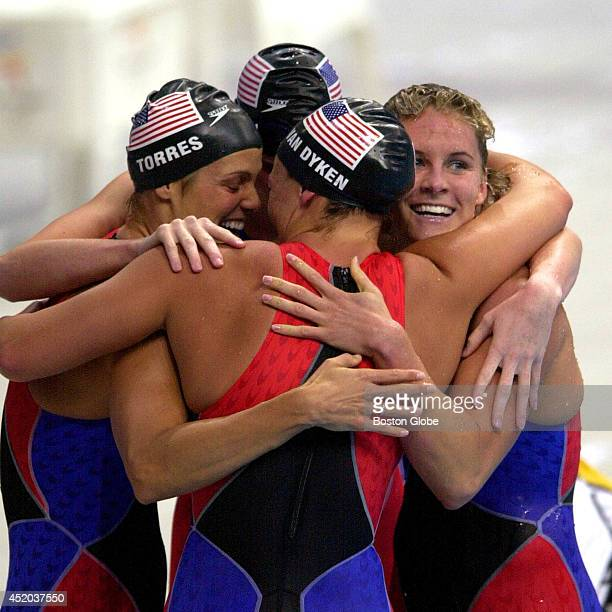 The US women's 4x100meter relay team reacts after setting a world record at 33661 Left to right Dara Torres Courtney Shealy Amy van Dyken and Jenny...