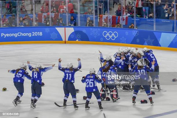 The US women's hockey team celebrates beating Canada 32 in a shootout following the women's gold medal hockey game between the USA and Canada during...