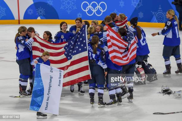 The US women's hockey team celebrates following the women's gold medal hockey game with the USA defeating Canada 32 in a shootout during the 2018...