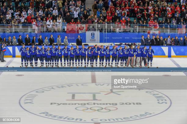 The US women's hockey team lines up for the National Anthem after beating Canada 32 in a shootout following the women's gold medal hockey game...