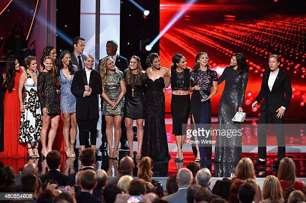 The US Women's National Soccer team accepts the award for Best Team from actor Vince Vaughn and NFL player Brett Favre during The 2015 ESPYS at...