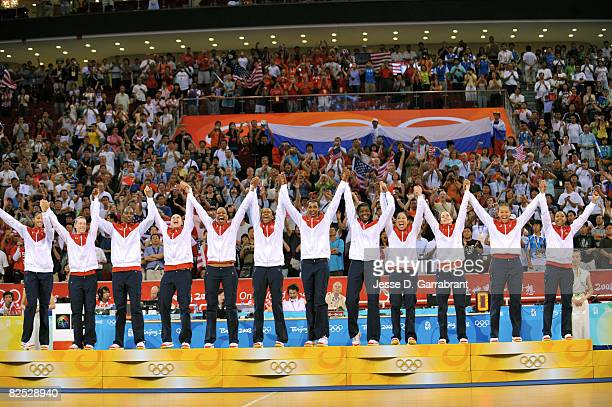The US Women's Senior National Team celebrate after winning the gold medal against Australia at the Beijing Olympic Basketball Gymnasium on Day 15 of...