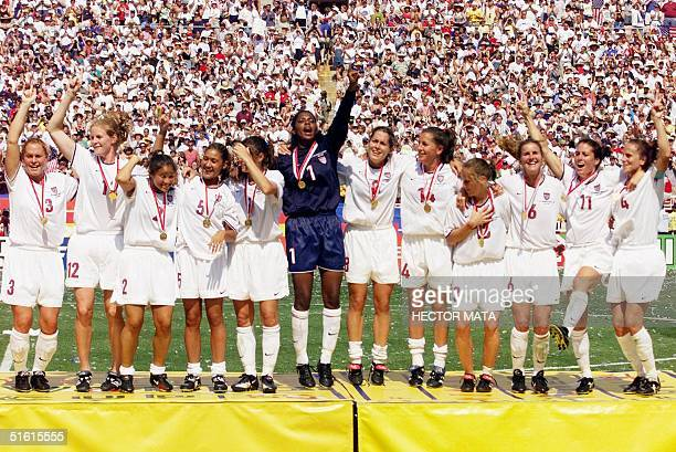 The US women's soccer team show off their gold medals after defeating China in a penalty kick shootout to win the 1999 Women's World Cup 10 July 1999...
