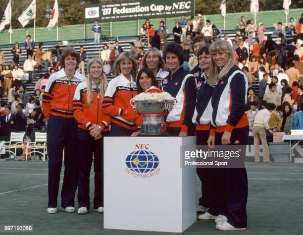 The USA and Great Britain Federation Cup teams pose together with the trophy ahead of the Final at the Tamagawaen Racquet Club in Tokyo Japan on...