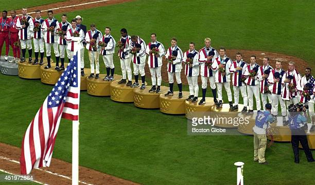 The USA baseball team watches from the gold medal stand as the American flag is raised and the national anthem is played The team beat Cuba 40 to win...