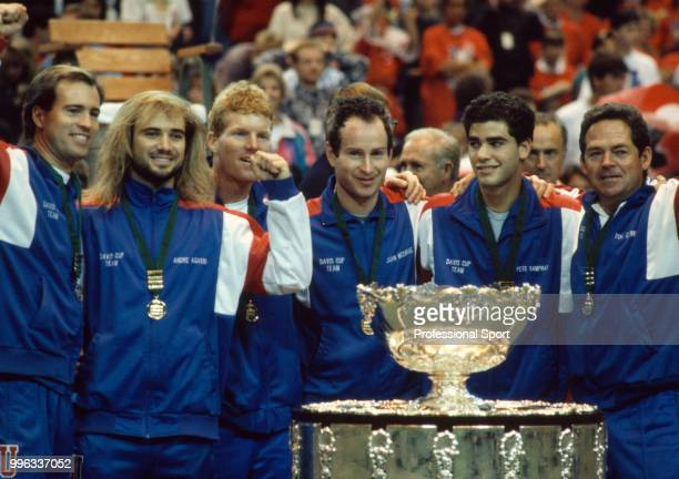 The USA Davis Cup team Rick Leach Andre Agassi Jim Courier John McEnroe Pete Sampras and Tom Gorman pose with the trophy after defeating Switzerland...