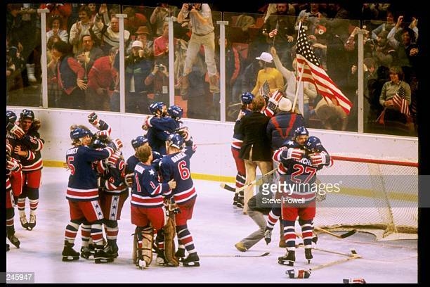 The USA hockey team celebrates winning the gold medal after defeating Finland 4-2 in the gold medal match during the 1980 Winter Olympic Games on...