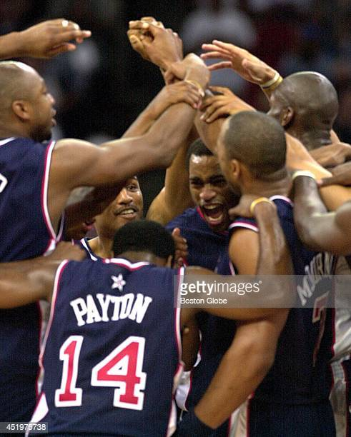 The USA men's basketball team celebrates after their win over France