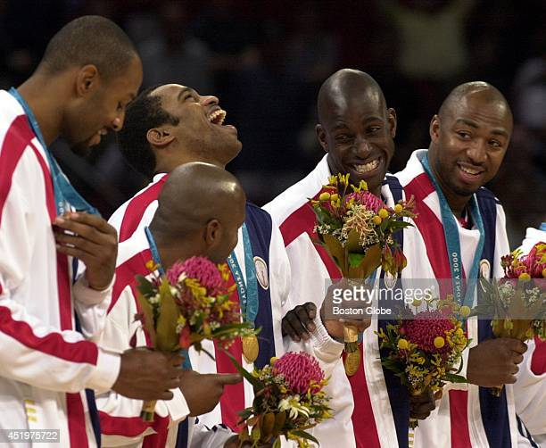 The USA men's basketball team rejoices after beating France