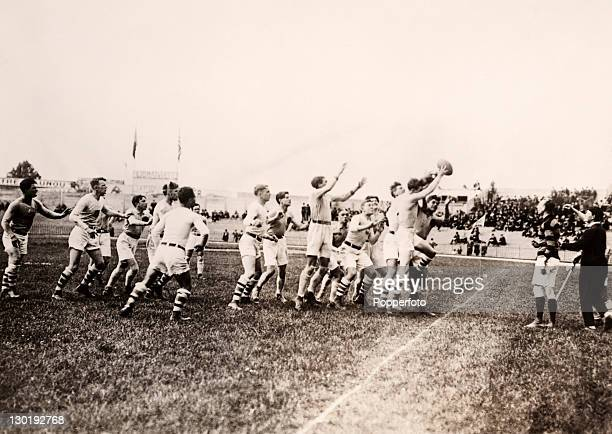The USA Olympic rugby union team puts the ball into play during their match against Romania in Paris circa July 1924 The three teams in competition...