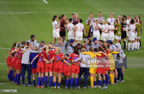 The USA players form a team huddle after the 2019 FIFA Women's World Cup France Semi Final match between England and USA at Stade de Lyon on July 02...