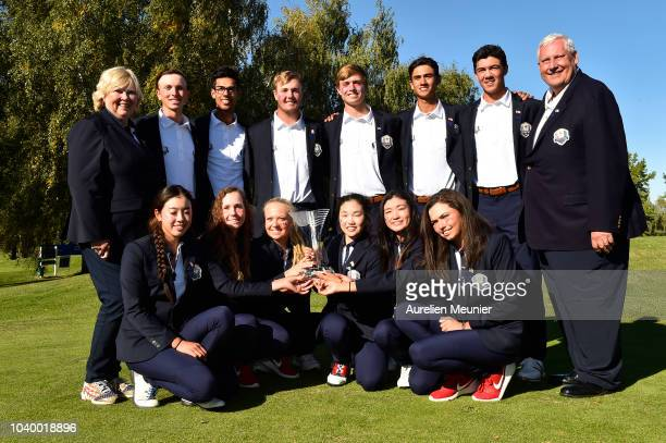 The USA pose with the trophy after victory on day two of the 2018 Junior Ryder Cup at Disneyland Paris on September 25 2018 in Paris France