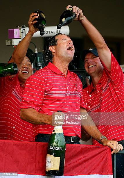 The USA team captain Paul Azinger celebrates with Anthony Kim and Dave Stockton after the USA 16 1/2 11 1/2 victory on the final day of the 2008...
