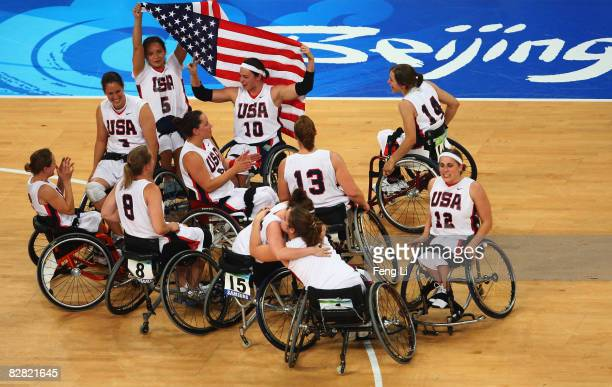 The USA team celebrate after winning the Gold in the Women's Wheelchair Basketball match between USA and Germany at the National Indoor Stadium...