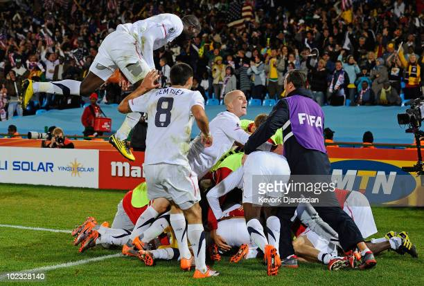 The USA team celebrate Landon Donovan's winning goal that sends the USA through to the second round during the 2010 FIFA World Cup South Africa Group...