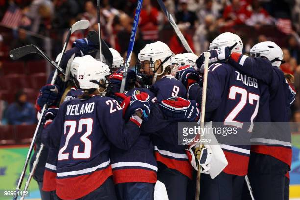 The USA team celebrate victory after the ice hockey women's semifinal game between Sweden and USA on day 11 of the Vancouver 2010 Winter Olympics at...