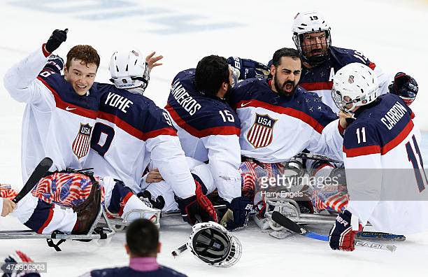 The USA team celebrate winning the Ice Sledge Hockey Gold Medal match between Russia and USA at the Shayba Arena during day eight of the 2014...