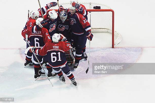 The USA team celebrates it's win against Russia in the men's ice hockey semifinal during the Salt Lake City Winter Olympic Games at the E Center in...